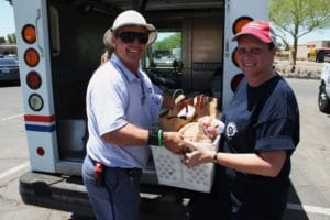 Dennis Kendrick from Cactus Station hands off to helper Karen Liberty